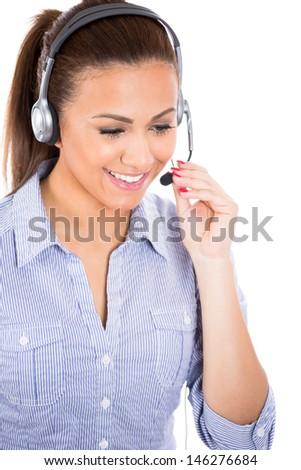 A portrait of a beautiful female customer service representative or operator or help desk support staff wearing a head set isolated on a white background - stock photo