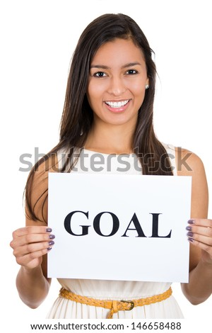 A portrait of a beautiful smiling, happy businesswoman holding a sign which says goal, isolated on a white background - stock photo