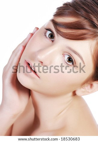 A portrait of a beautiful teenage girl, on a white background. - stock photo