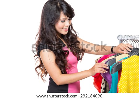 A portrait of a beautiful woman choosing clothes in a store, isolated - stock photo