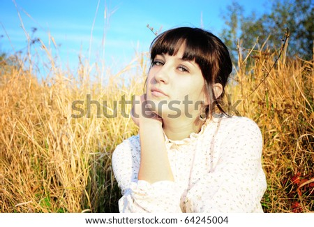 a portrait of a beautiful woman in a countryside