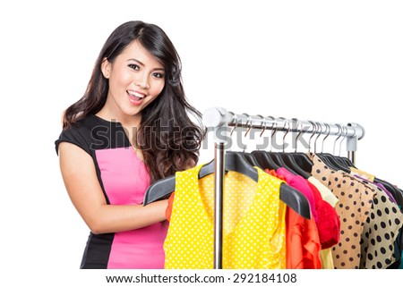 A portrait of a beautiful woman with a lot of shopping bags - stock photo