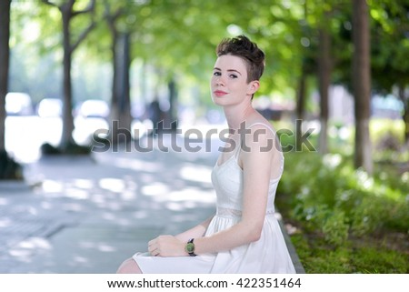 A portrait of a beautiful young Caucasian woman outdoor - stock photo