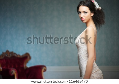 A portrait of a beautiful young girl in a wedding dress - stock photo
