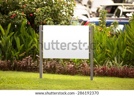 A portrait of a blank billboard for advertisement in the garden - stock photo
