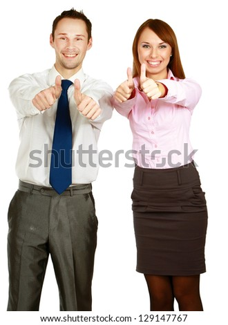 A portrait of a businesswoman and a businessman standing and showing ok isolated on white background