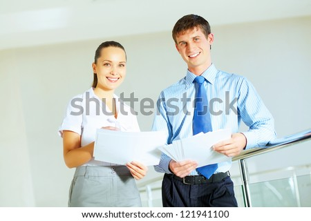 A portrait of a businesswoman and a businessman working together as a team im the office