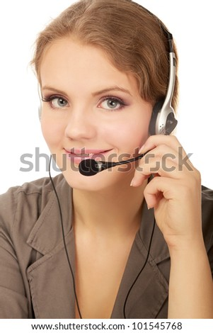 A portrait of a call center employee wearing headset, isolated on grey background