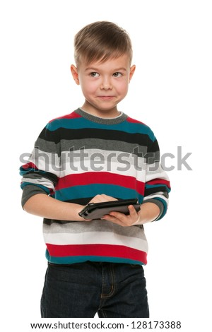 A portrait of a cheerful boy with a smartphone; isolated on the white background - stock photo