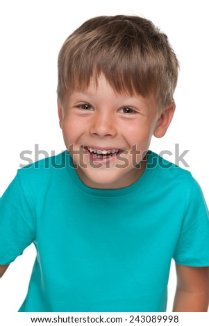 A portrait of a cheerful little boy in a blue shirt on the white background - stock photo