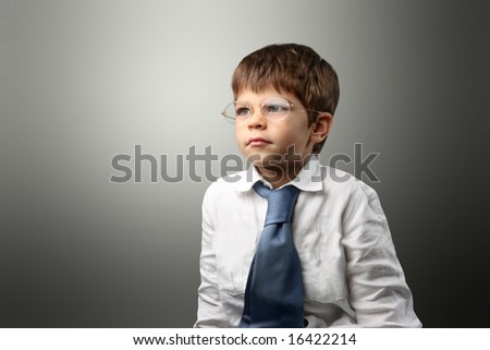 a portrait of a child with  tie
