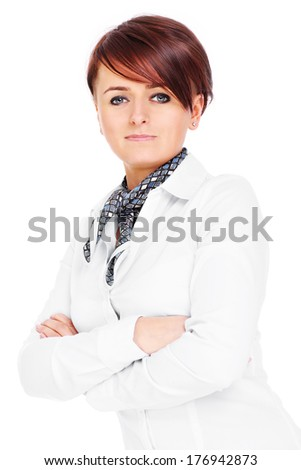 A portrait of a confident businesswoman posing over white background