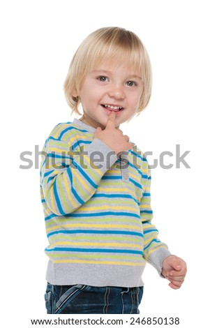 A portrait of a curious little boy on the white background - stock photo