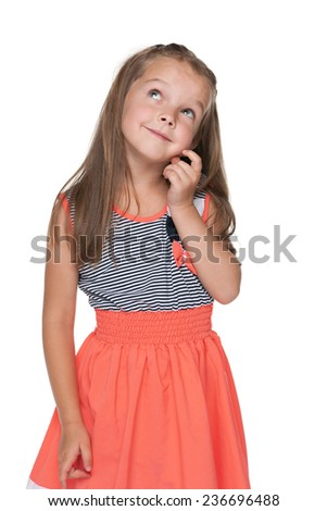 A portrait of a curious little girl looking up on the white background - stock photo