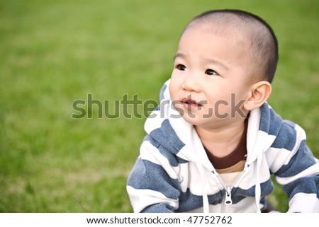 A portrait of a cute asian boy - stock photo