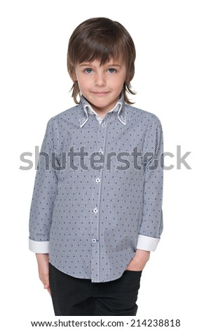 A portrait of a cute fashion young boy against the white background