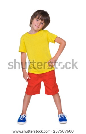 A portrait of a cute little boy in the yellow shirt - stock photo
