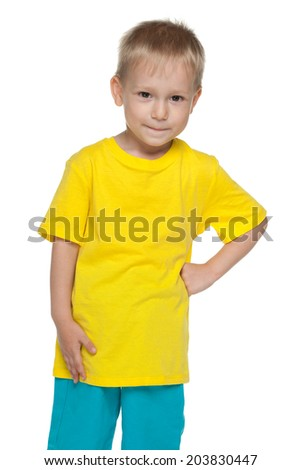 A portrait of a cute little boy in the yellow shirt on the white background