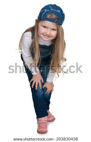 A portrait of a cute preschool girl on the white background - stock photo