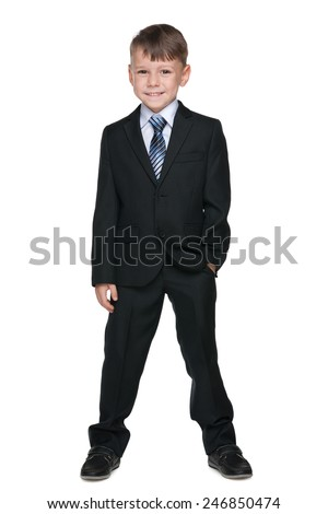 A portrait of a cute schoolboy against the white background