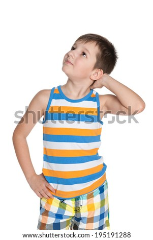 A portrait of a dreaming little boy on the white background - stock photo