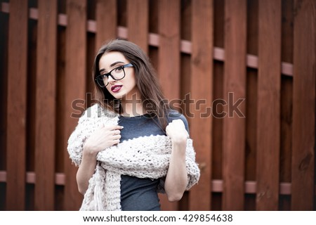 Beautiful Blonde Girl Nude Make Wearing Stock Foto               BBC com Beautiful blonde girl with nude make up wearing gray blouse and scarf   wearing headphones and