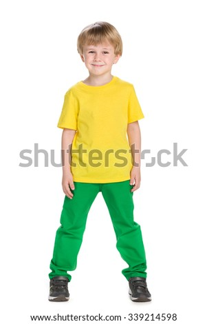 A portrait of a fashion cute little boy against the white
