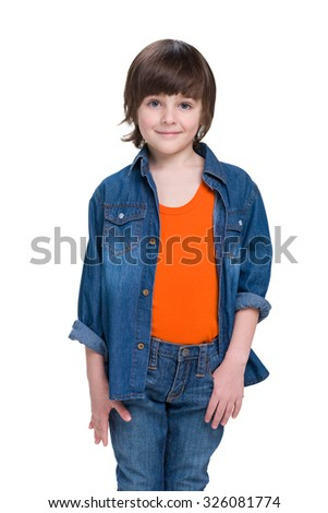 A portrait of a fashion smiling little boy in a jeans suit - stock photo