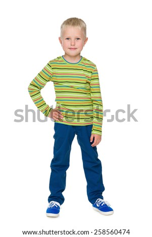 A portrait of a fashion smiling little boy in the blue pants