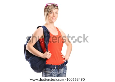 A portrait of a female student with school bag isolated on white background - stock photo