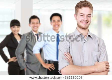 A portrait of a group of mix-raced young businessperson, isolated in white background - stock photo