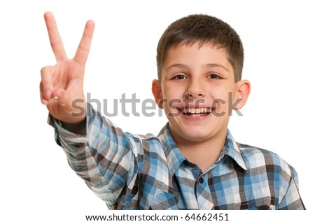 A portrait of a handsome boy holding victory sign over his head; isolated on the white background