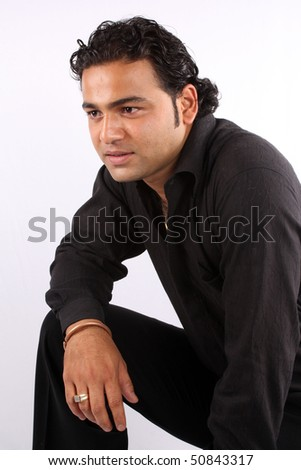 A portrait of a handsome Indian guy, on white studio background. - stock photo