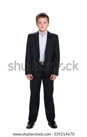 A portrait of a handsome schoolboy in the suit