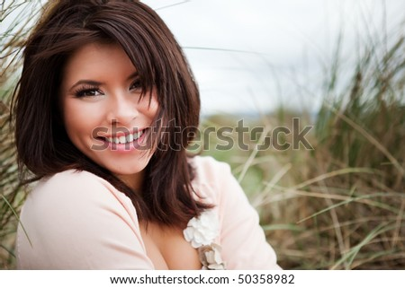 A portrait of a happy beautiful mixed race girl outdoor
