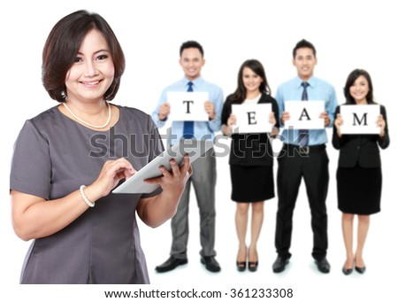 A portrait of a happy mature business women with her staff, teamwork concept - stock photo