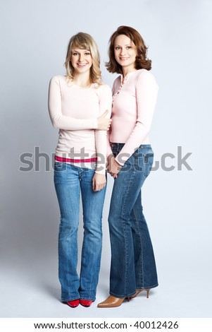 A portrait of a happy mother and daughter - stock photo