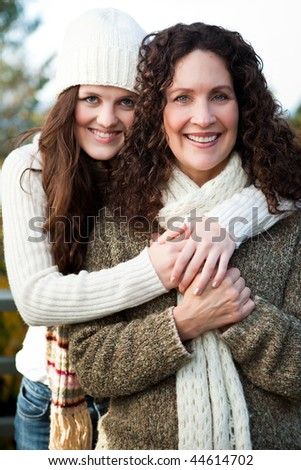 A portrait of a happy mother and daughter outdoor - stock photo