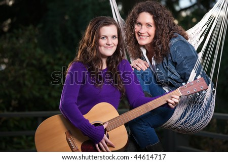 A portrait of a happy mother and daughter relaxing outdoor