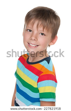 A portrait of a happy young boy in a striped shirt on the white background - stock photo