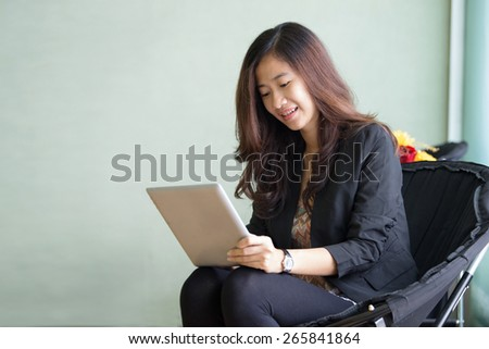 A portrait of a Happy young Businesswoman with a tablet pc - stock photo