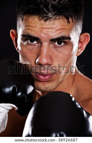 A portrait of a hispanic male boxer - stock photo