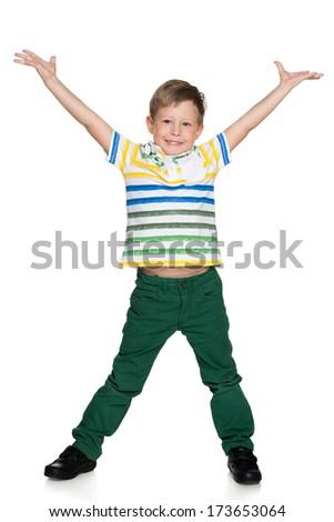 A portrait of a joyful little blond boy on the white background - stock photo