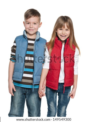 A portrait of a laughing girl and a smiling boy on the white background - stock photo