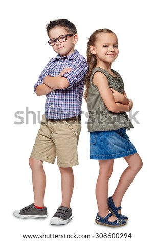 A portrait of a laughing girl and a smiling boy on the white background. - stock photo
