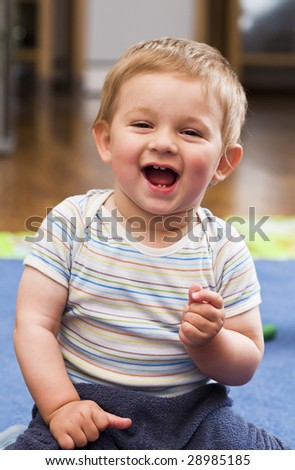 A portrait of a laughing happy child - stock photo