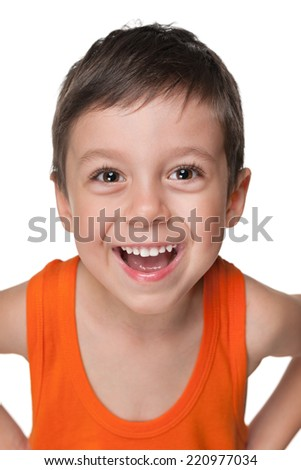 A portrait of a laughing little boy against the white background - stock photo