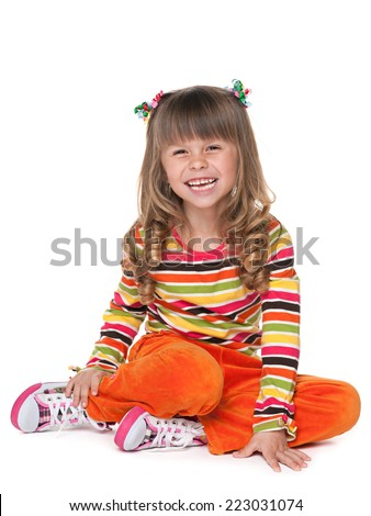 A portrait of a laughing little girl on the white background - stock photo