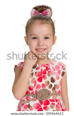 A portrait of a laughing little girl on the white background