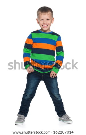 A portrait of a laughing young boy on the white background - stock photo